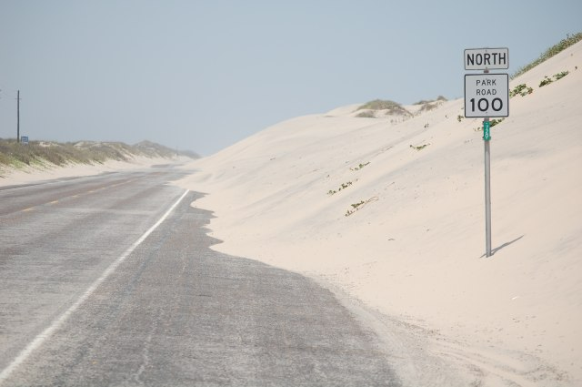 Sand dunes reclaiming road